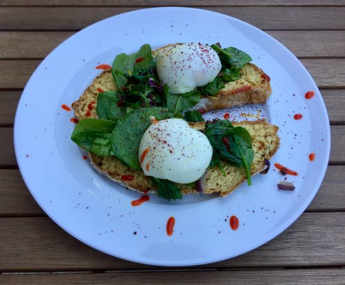 Poached eggs and spinach on soda bread